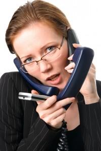 Secretary with phones