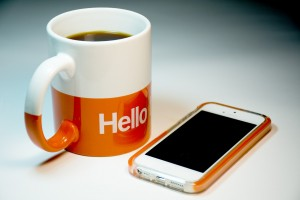coffee mug and iPhone