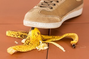 a foot about to step on a banana peel